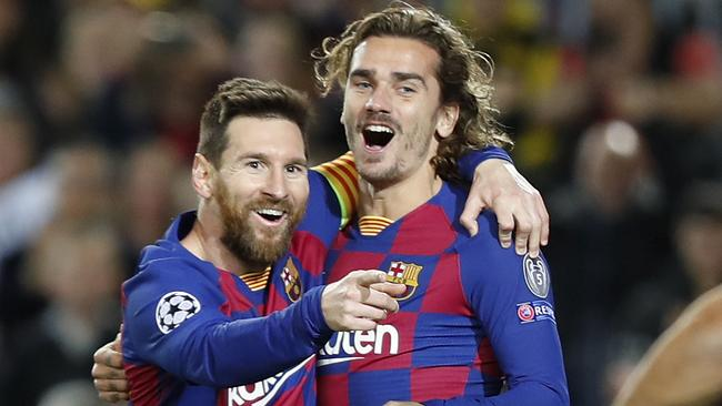 Mombaerts says Antoine Griezmann, pictured with Barcelona superstar Leo Messi, slipped through the national team cracks as a youth. Picture: AP