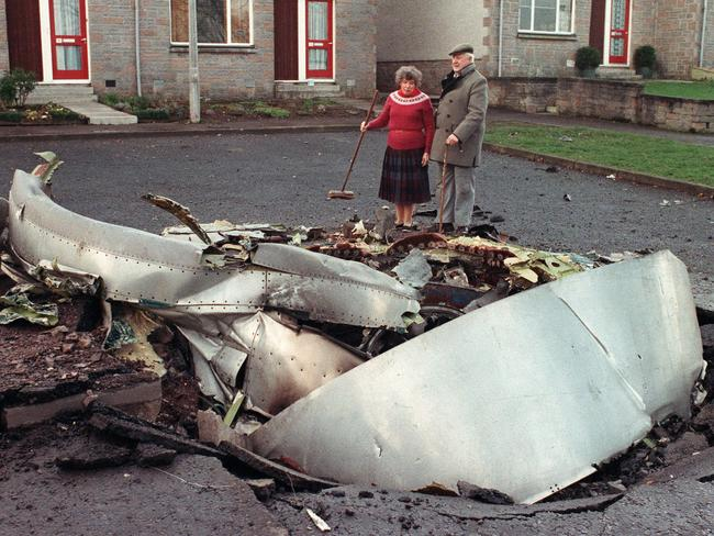 The clean up ... residents of Lockerbie, Scotland, look at the wreckage of Pan Am Flight 103. Picture: Roy Letkey