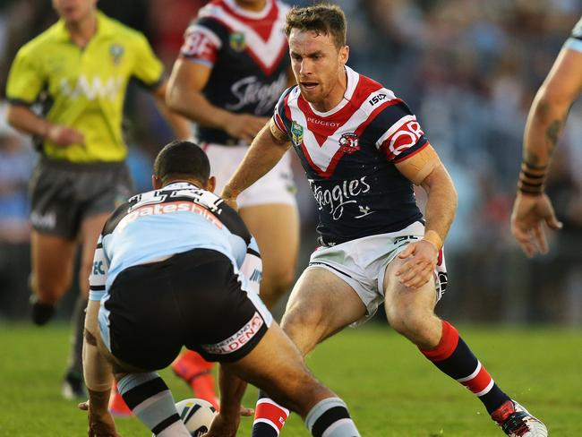 Roosters No.6 James Maloney lines up against the Sharks this season.