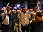 People leave the area with their hands up after an incident near London Bridge in London. Picture: Reuters