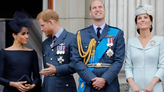 Meghan, Prince Harry, Prince William and Kate stand on the balcony of Buckingham Palace to watch a military fly-past to mark the centenary of the Royal Air Force (RAF) in 2018. Picture: Tolga Akmen/AFP