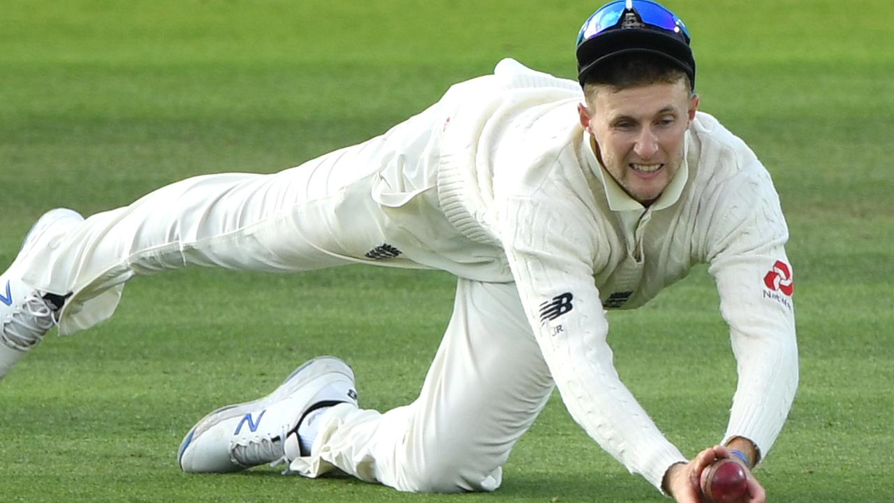England captain Joe Root dives to catch replacement batsman Marnus Labuschagne.