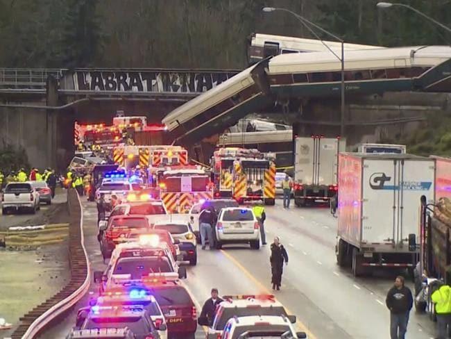 The train careened off of a bridge 64km south of Seattle. Picture: KOMO-TV via AP
