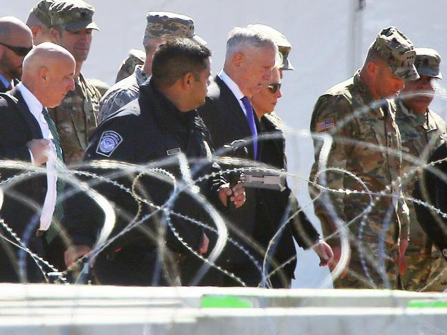 U.S. Secretary of Defence James Mattis and Homeland Security Secretary Kirsten Nielsen, third from the right, visit Base Camp Donna, Texas. Picture: AP