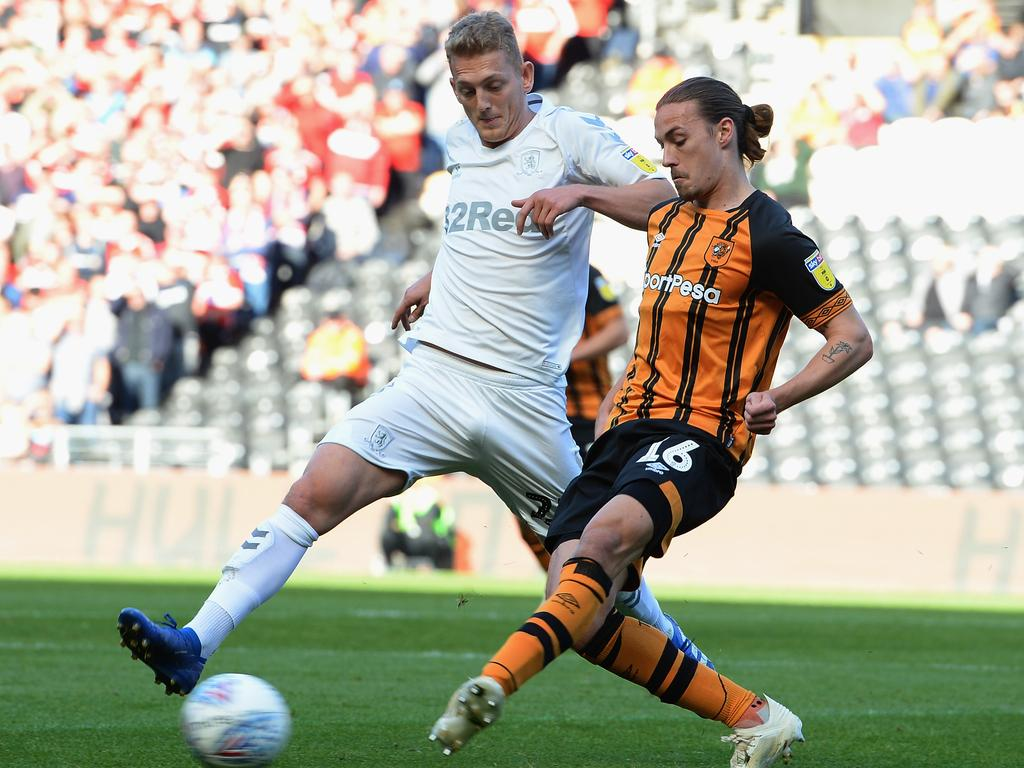 HULL, ENGLAND - SEPTEMBER 29: George Saville of Middlesbrough tackles Jackson Irvine of Hull City during the Sky Bet Championship match between Hull City and Middlesbrough at KCOM Stadium on September 29, 2018 in Hull, England. (Photo by Tony Marshall/Getty Images)