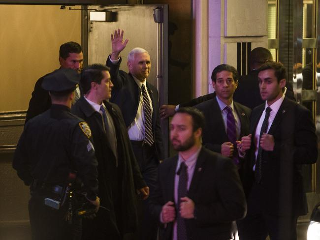 Vice President-elect Mike Pence, top centre, leaves the Richard Rodgers Theatre after a performance of Hamilton in New York. Picture: AP Photo/Andres Kudacki