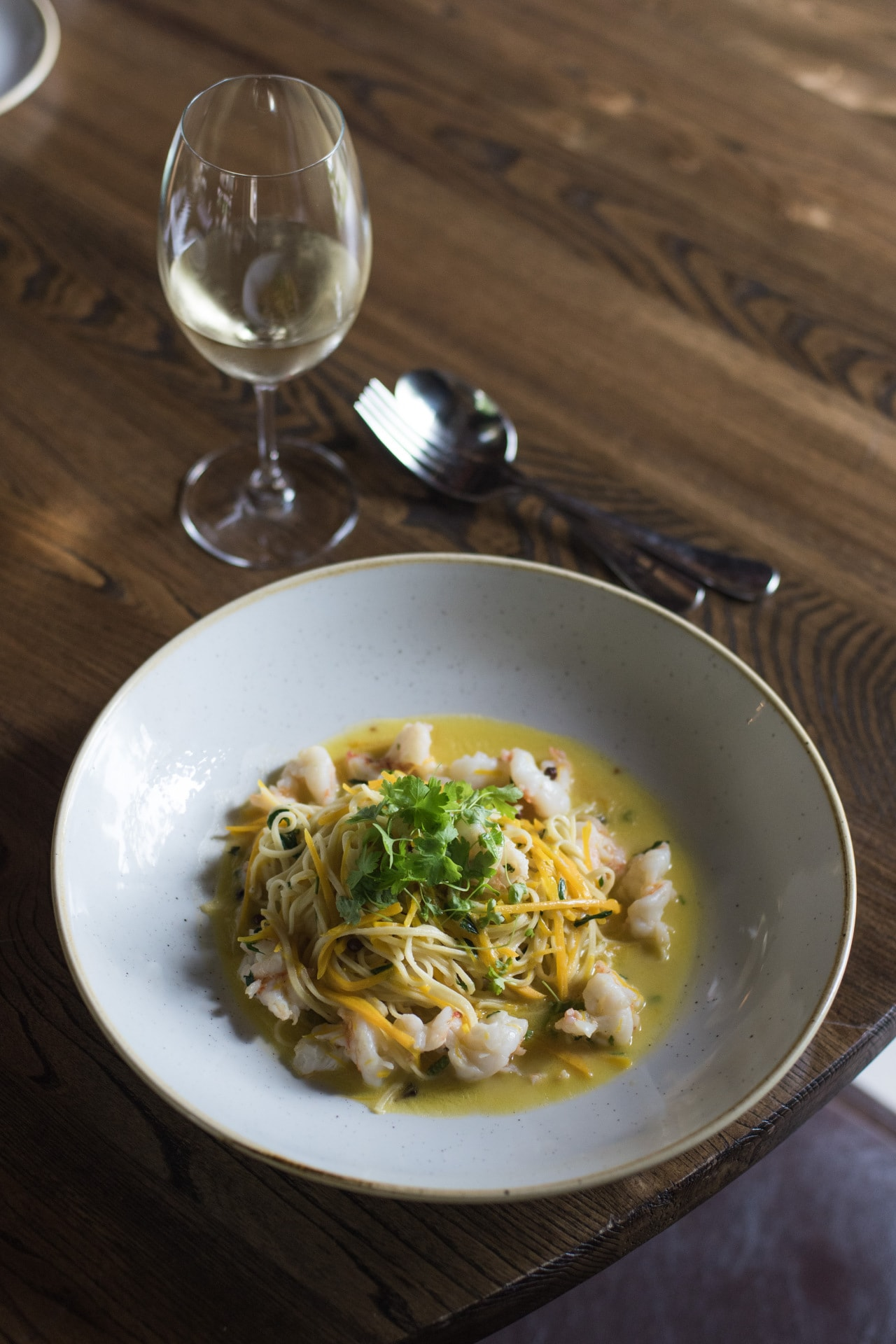 Recipe: spaghetti alla chitarra with prawns, pumpkin, white wine and pink peppercorns