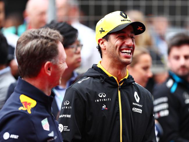 Ricciardo shares a joke with Horner.