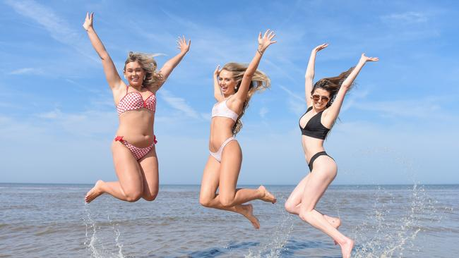 Making a splash … three friends cool down on Formby beach, Merseyside. Picture: Mercury Press/Caters News