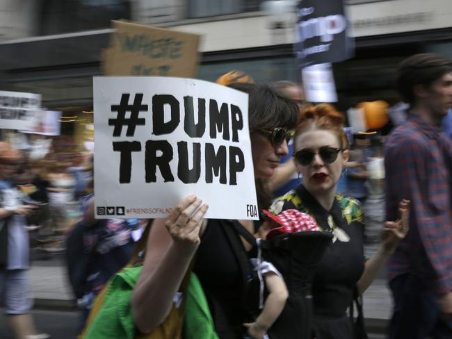 'Dump Trump' signs were commonplace, along with placards reading 'Fight racism' and 'Ban guns not Muslims'. Picture: AP Photo/Luca Bruno