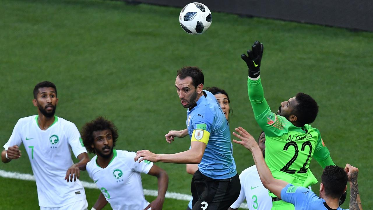 Saudi Arabia's goalkeeper Mohammed Al-Owais flaps at a cross leading to the opening goal.