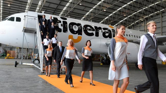 Walking the orange catwalk in their fancy new outfits. Photo: James Morgan.