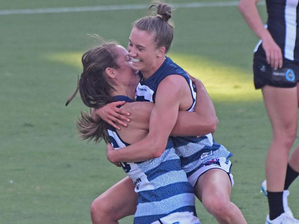 Maddie Boyd gets swamped by teammates after kicking the first ever goal for the Geelong AFLW team. Picture: Stephen Harman