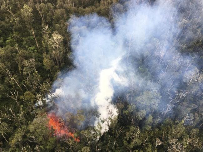 Smoke rises from a fissure in Leilani Estates in Pahoa, Hawaii. Hawaii's erupting Kilauea volcano has destroyed homes and forced the evacuations of more than a thousand people. Picture: U.S. Geological Survey via AP