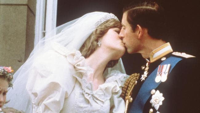 Charles and Diana had their first kiss as newlyweds on the balcony of Buckingham Palace. Picture: AFP