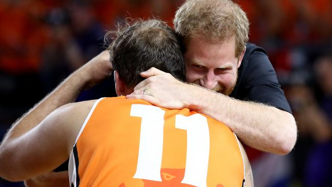 Prince Harry embraces Marc Van De Kuilen of the Netherlands following the gold medal match of the wheelchair basketball between the Netherlands and the United States. Picture: Cameron Spencer/Getty Images for the Invictus Games Foundation.
