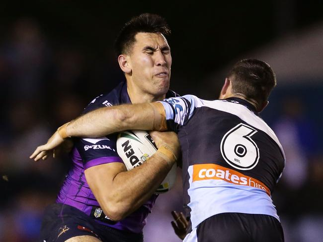 Nelson Asofa-Solomona of the Storm takes a hit-up.