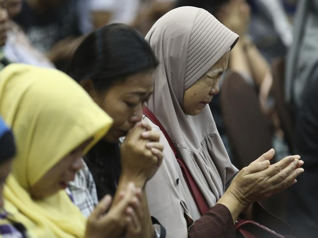 Relatives pray for victims after the tragedy. Picture: AP/Achmad Ibrahim