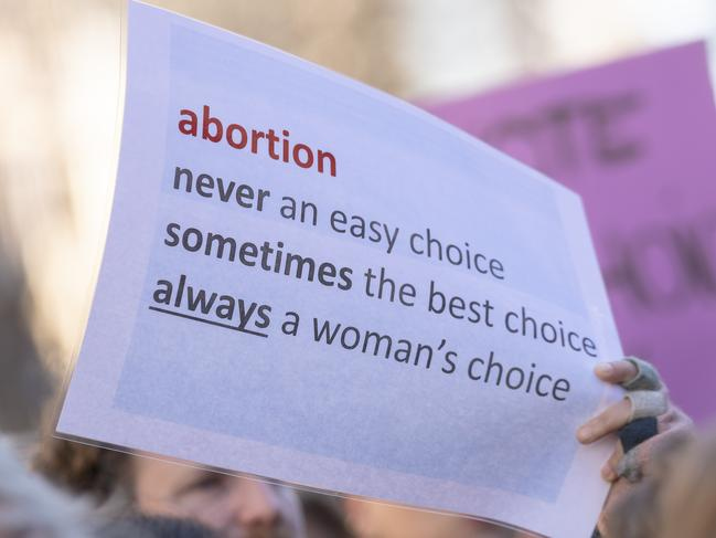 A pro-choice placard is pictured during an early morning rally at Parliament House in support Of decriminalising abortion. Picture: Brook Mitchell/Getty Images