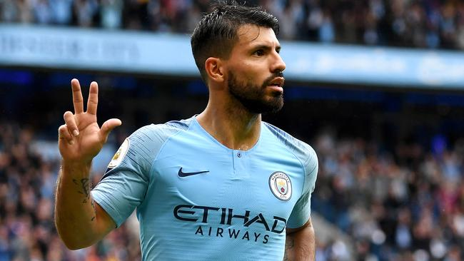 Manchester City's Sergio Ageuro celebrates bringing up his hat-trick against Huddersfield Town on Sunday. Picture: Getty Images