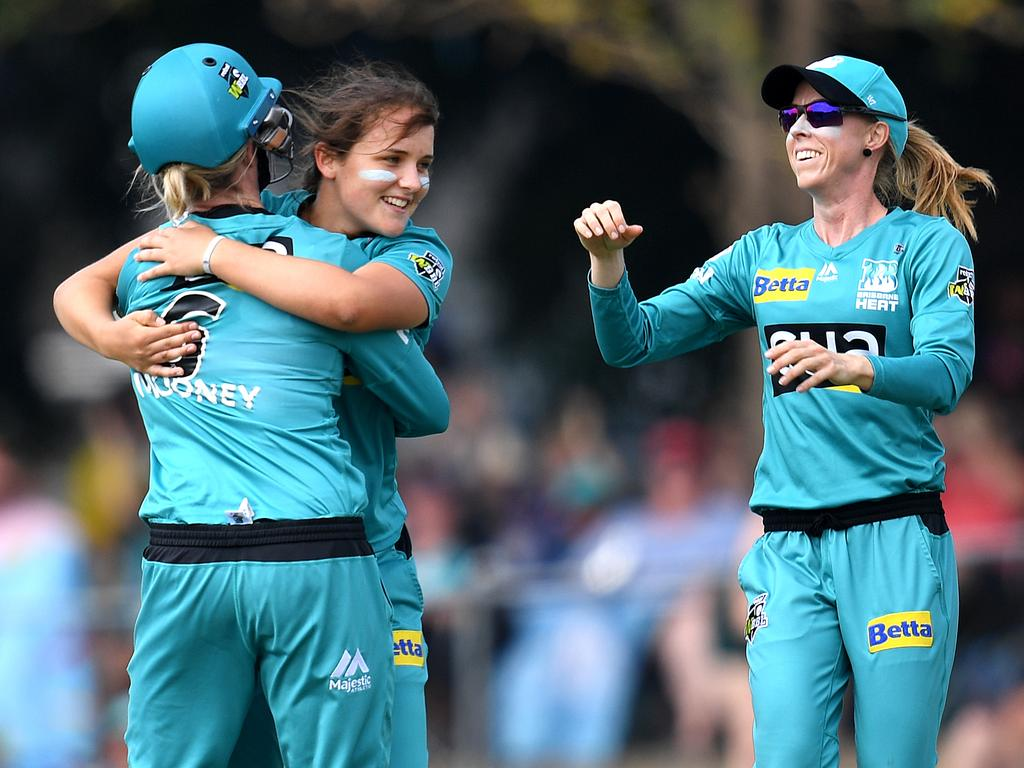 Amelia Kerr of the Heat (centre) hugs teammate Beth Mooney and joined by Kirby Short (right) as she celebrates taking the wicket of Suzie Bates of the Strikers during the Women's Big Bash League (WBBL) final between the Brisbane Heat and the Adelaide Strikers at Allan Border Field in Brisbane, Sunday, December 8, 2019. (AAP Image/Dan Peled) NO ARCHIVING, EDITORIAL USE ONLY