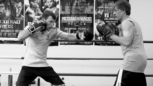Jeff Horn works the pads with trainer Glenn Rushton.
