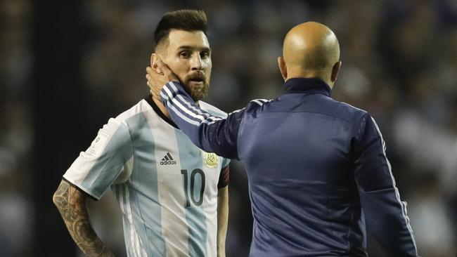 Messi is comforted by Argentina coach Jorge Sampaoli.