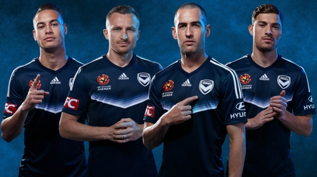 Melbourne Victory players in the club's new home kit.