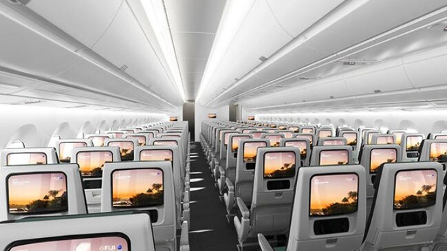 The interior of the economy cabin has spacious seats and large video screens. Picture: Supplied