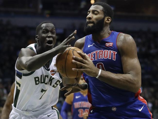 Milwaukee Bucks' Thon Maker fouls Detroit Pistons' Andre Drummond.