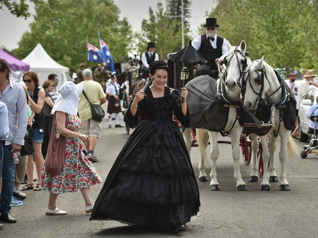 A woman dressed in Victorian clothing performs in a parade at Rookwood. Picture: AFP/Peter Parks