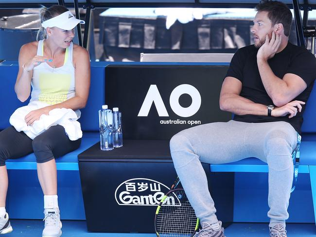 Caroline Wozniacki talks with fiancee and former NBA player David Lee. (Photo by Michael Dodge/Getty Images)