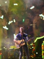 Chris Martin out front of Coldplay at Suncorp Stadium, Brisbane, on December 6. Pic: Marc Robertson
