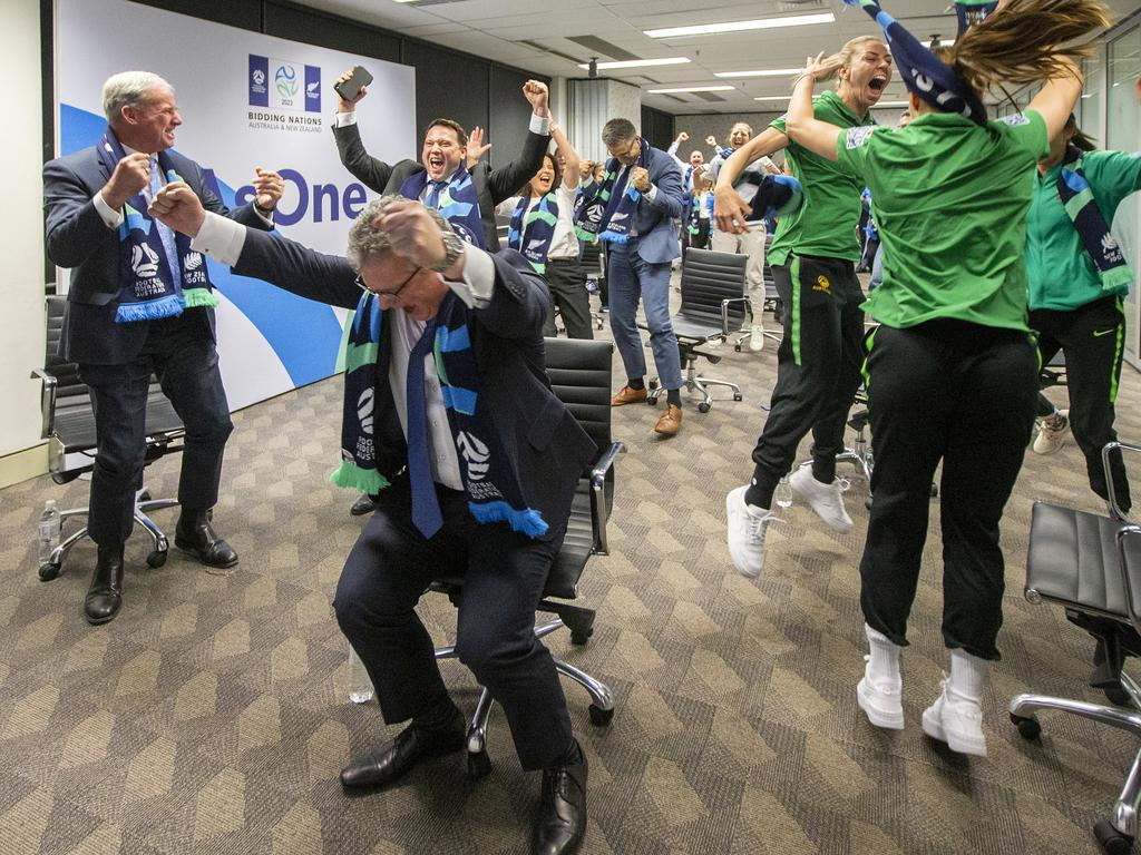 Chris Nikou, Chairman of Football Federation Australia (C) along with officials and players celebrate.