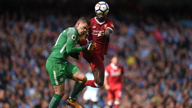 Liverpool's Sadio Mane is sent off for this challenge on Ederson.