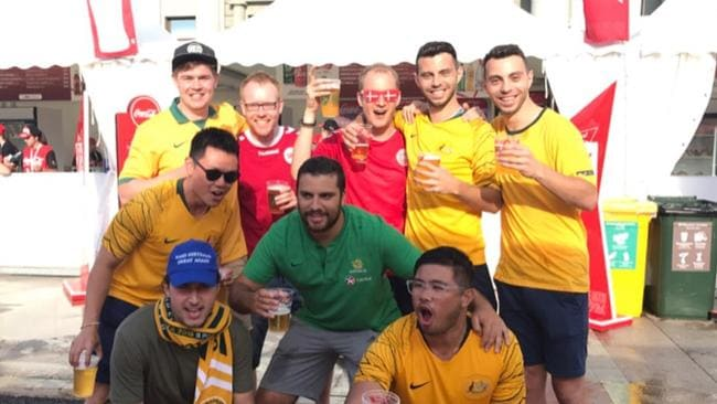 Socceroos fans including Daniel Solari, second from left, with Danish fans at the Samara Kuibyshev Square, Russia during the 2018 FIFA World Cup. Picture: Supplied