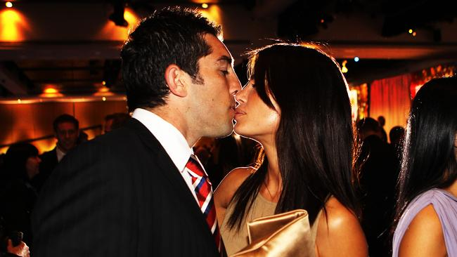 The couple share a kiss at the 2010 NRL Grand Final breakfast. Picture: Christian Wright