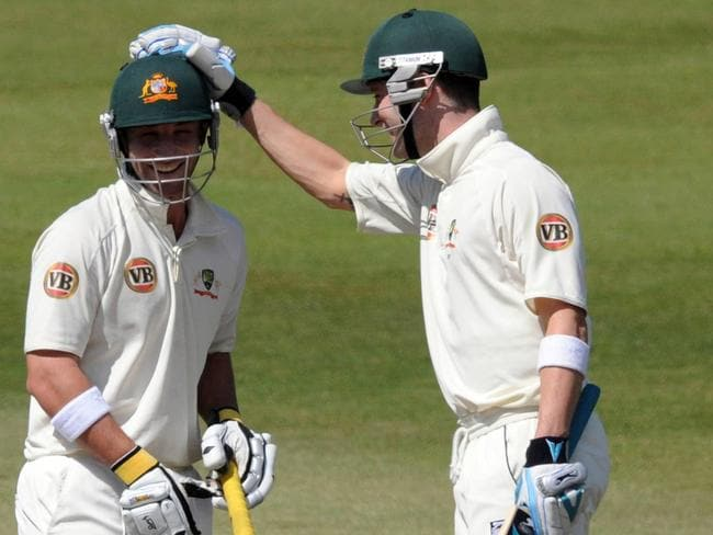 Michael Clarke congratulates Phillip Hughes after he passed 150 against South Africa in 2009.