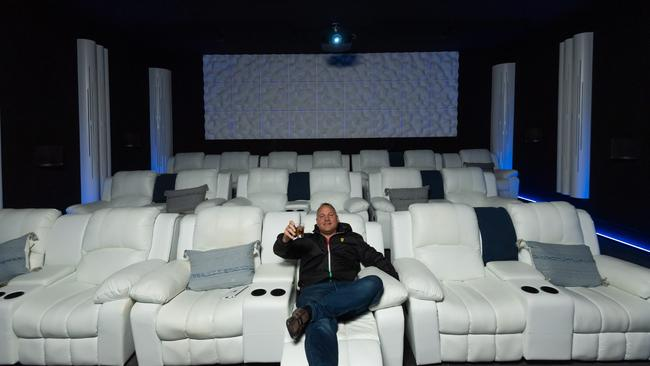 Builder and owner Mark Spinosa inside the Balwyn North house's 25-seat cinema. Picture: Jason Edwards