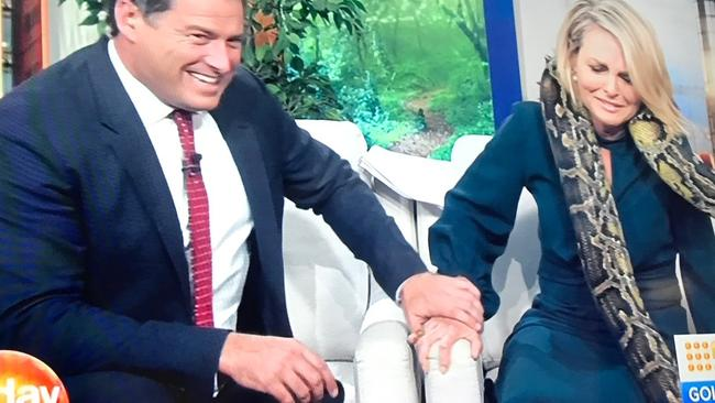 Karl gives his co-host a reassuring hand hold.