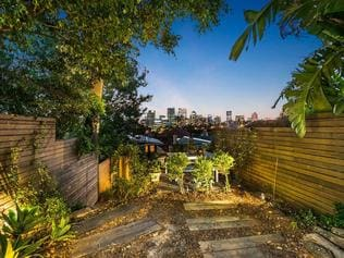 The property has a rear courtyard, suitable to entertain guests while enjoying the North Sydney views.