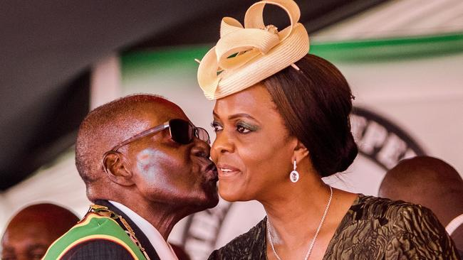 Then-President Robert Mugabe kisses his wife and first lady Grace Mugabe during the country's Independence Day celebrations at the National Sports Stadium in Harare. Picture: AFP