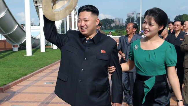 Kim Jong Un and his wife wave to the crowd as they inspect the Rungna People's Pleasure Ground in Pyongyang, North Korea - on 25th July 2012. Photo: AP Photo