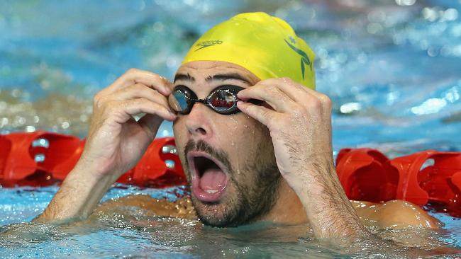 Christian Sprenger adjusts his goggles durin training.