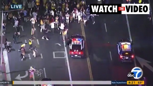 Los Angeles: 76 arrested, eight cops injured after Lakers win