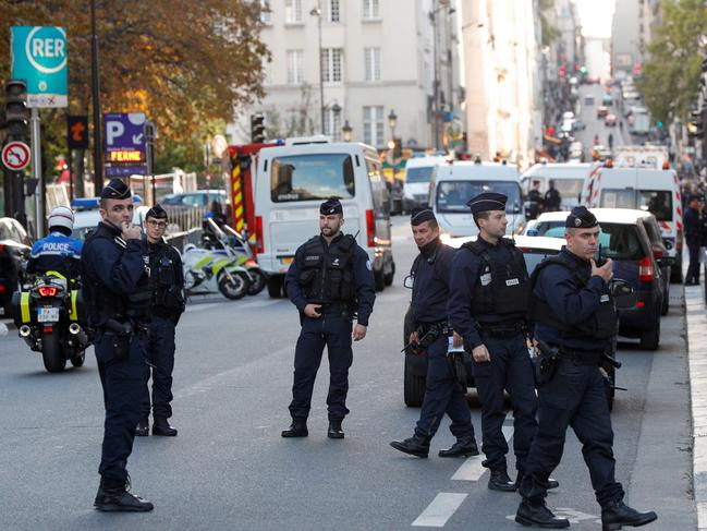 A knife-wielding man working at police headquarters in central Paris went on a rampage on October 3, stabbing and killing four employees before himself being shot dead, officials said. Picture: Geoffroy Van Der Hasselt