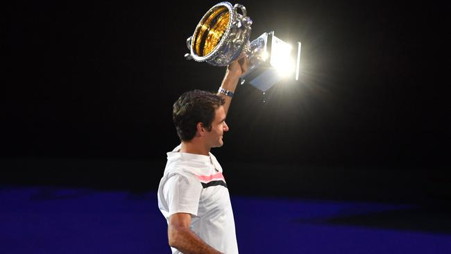 Switzerland's Roger Federer holds the Australian Open winner's trophy.
