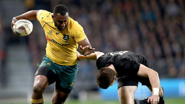 Tevita Kuridrani of the Wallabies is tackled by Beauden Barrett of the All Blacks.