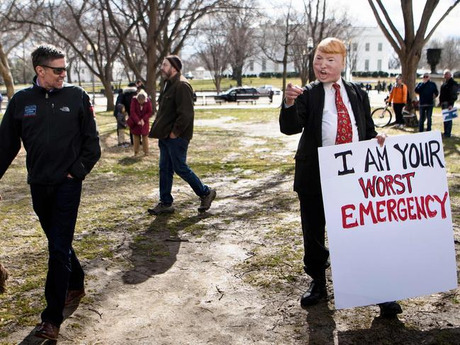 The complainants say Mr Trump's use of an emergency declaration to divert funds for his wall is unconstitutional because there is no 'crisis' on the border. Picture: Brendan Smialowski / AFP