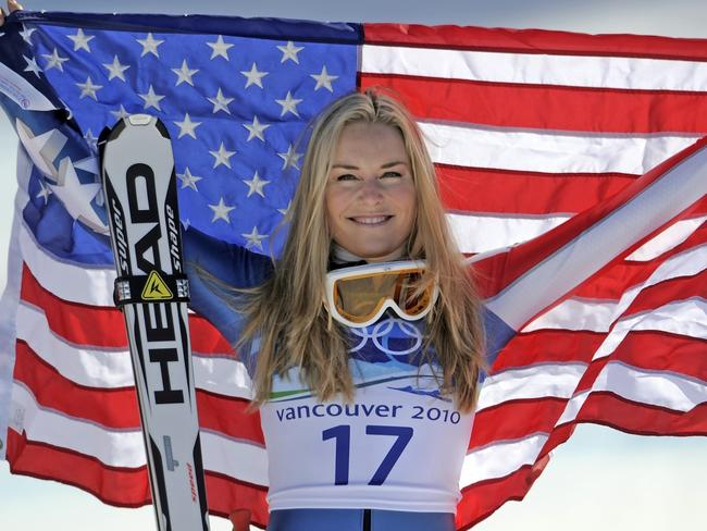 Bronze medallist Lindsey Vonn of the United States hold the Stars and Stripes during the flower ceremony for the Women's super-G at the Vancouver 2010 Olympics in Whistler, British Columbia. Picture: AP